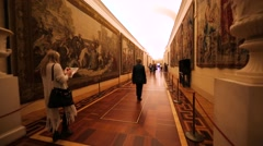 Walking along the corridor with tapestries in Hermitage Museumj, St Petersburg Stock Footage