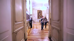 Entering white show room with big pictures in Hermitage Museum, St Petersburg Stock Footage