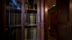 View of books in bookcase, interior of wooden show room in Hermitage Museum Stock Footage
