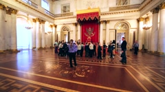 Group of pupils with museum guide in throne room of Hermitage, St Peterburg Stock Footage