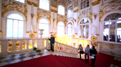 View of staircase with red carpet and hall in Hermitage Museum, St Petersburg Arkistovideo