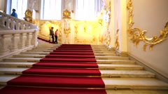 Ascending on splendid staircase with red carpet in Hermitage Museum, Petersburg Stock Footage