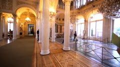 One of show rooms with great chandeliers and marbled columns in Hermitage Museum Stock Footage