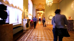 Walking through the rooms with exhibit items in Hermitage Museum, St Petersburg Stock Footage