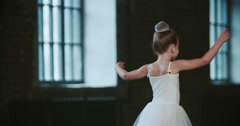 Little girl dreams of becoming a ballerina, and makes no attempt to implement Stock Footage