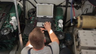 Repairer performs diagnostics of the yacht engine Stock Footage