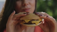 Portrait of a girl close-up with a hamburger in his hand. Stock Footage
