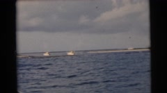 1956: boats on the ocean near the shoreline as seen from a moving vessel FLORIDA Stock Footage