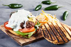 Gourmet burger with spinach and spicy jalapenos Stock Photos