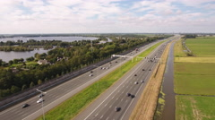Flying along highway traffic in Holland. Stock Footage