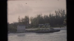 1956: the shore of a lake with many houses and buildings FLORIDA Stock Footage
