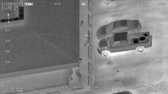 Aerial IR Footage of Pedestrians Walking by Bait Car Stock Footage