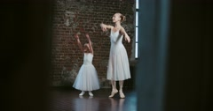 Adult ballerina coached a little girl daughter to dance class Stock Footage
