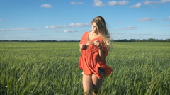 Beautiful young blond woman with the sexy look standing and enjoying herself at Stock Footage