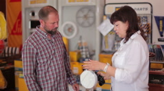 Consultant shows water filter at yacht centre Stock Footage