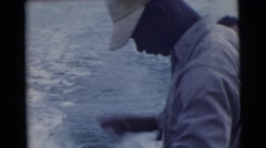 1967: man on a boat helps rig fishing pole for chartered trip CAMDEN, NEW JERSEY Stock Footage