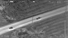 Aerial IR Footage of Bait Pickup Truck Being Pulled Over by Police Patrol Car Stock Footage