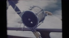 1956: a man sailing swiftly while unties a knot in a rope of the boat FLORIDA Stock Footage