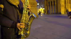 Musician playing saxophone music, nice romantic atmosphere, date in night city Stock Footage
