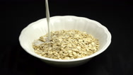 Pouring Milk On Oat Flakes Slow Motion Video Stock Footage