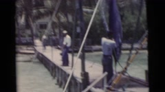 1956: men on a wooden fishing dock inspecting their large catch of the day Stock Footage