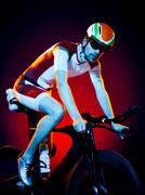 Man cyclist cycling bicycle triathlon isolated Stock Photos