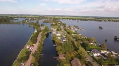Road and houses across lake, Holland. Aerial perspective. Stock Footage