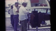 1956: people are seen standing beside a car FLORIDA Stock Footage