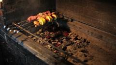 Man prepares shish cebab on barbeque Stock Footage