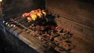 Man prepares shish cebab on barbeque Stock Footage