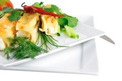Cannelloni served with greenery on white Stock Photos