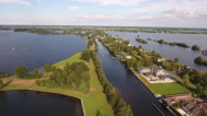 Road and houses in Holland surrounded by water, aerial. Stock Footage