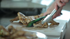 Cook chops prepared chicken on the cutting board Stock Footage