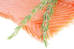 Fresh uncooked salmon fillet with rosemary Stock Photos