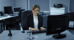 4K: A young employee sits tensely in her office. Stock Footage