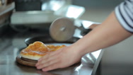 Cook chops pizza into eight pieces Stock Footage