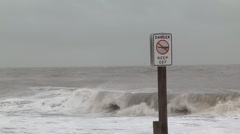 Waves.warning sign and tropical storm julia Stock Footage
