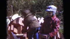 1967: the boys are picking blocks from the ground and building something CAMDEN, Stock Footage
