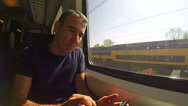 Man Using Cell Phone On Train Stock Footage
