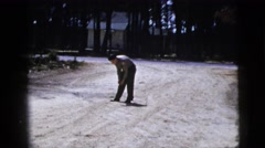 1967: man drops ball and then turns to get it, he then throws it back to other Stock Footage