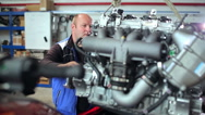 Repairers work on the engine at the yacht centre Stock Footage