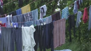 Laundry on a clothes line in rain Stock Footage