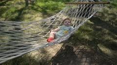 Little cute baby boy relax on a hammock Stock Footage