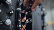 Repairer tests wiring at the yacht centre Stock Footage
