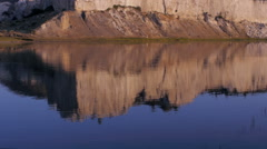Reflection in the water of the white cliffs along the Missouri River in Montana Stock Footage