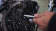 Mechanic screws in the bolt by the electric wrench Stock Footage