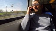 Man Traveling By Train Using Cellphone Stock Footage