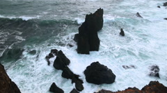 Rugged rocky coastline breaking waves on sea stacks Reykjanes Iceland Stock Footage