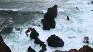 Rugged rocky coastline breaking waves on sea stacks Reykjanes Iceland Stock Footage
