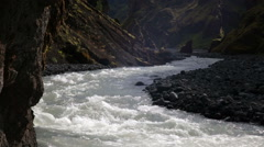 Glacial river through rugged mountain valley Thorsmork Iceland highlands Stock Footage